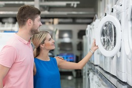 Couple At Groceries Store Buy Washing Machine Fotolia 131692582